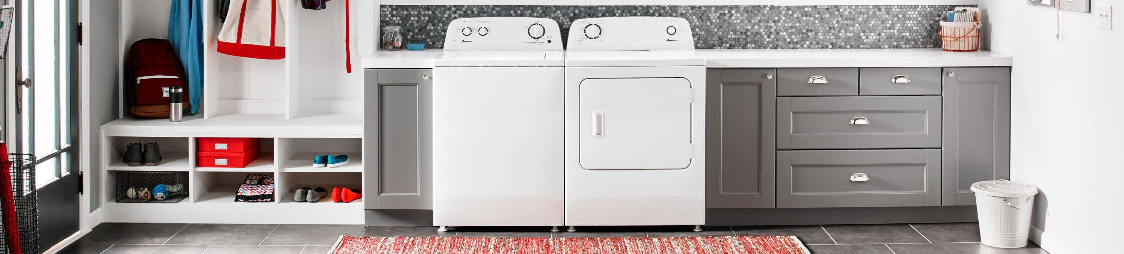 Amana® washer and dryer pair in laundry room