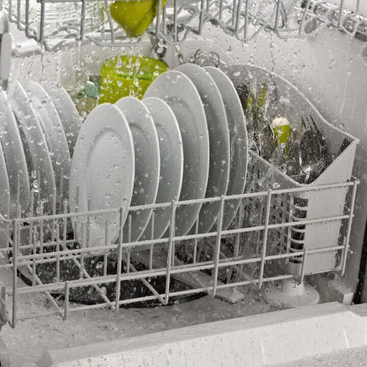 Side interior view of dishes in dishwasher