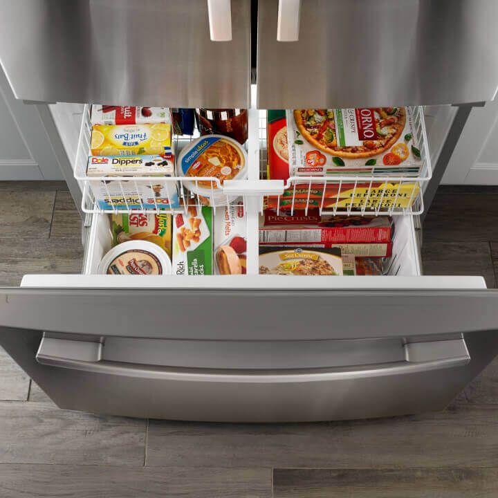 Refrigerator with bottom freezer drawer open