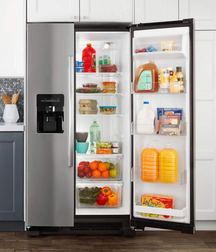 Amana® side-by-side refrigerator with door open