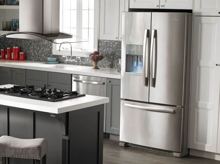 Amana® side-by-side bottom-out refrigerator in kitchen