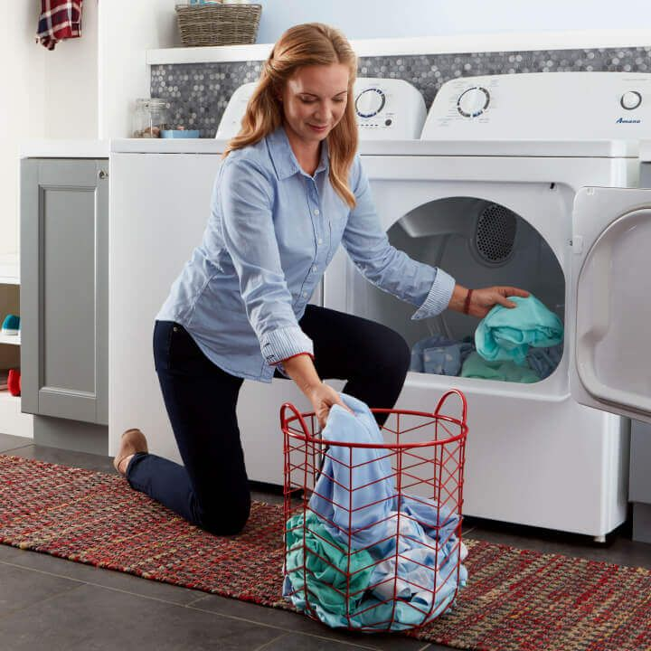 Person unloading clothes from a dryer