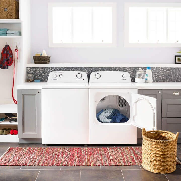 Amana® washer and dryer pair with dryer door open