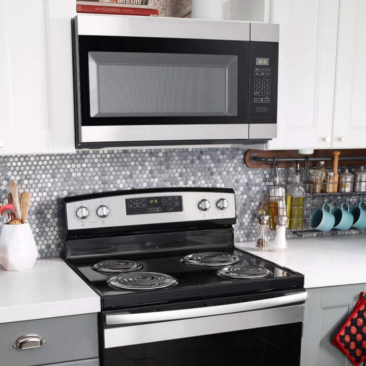 Amana® range and microwave in kitchen