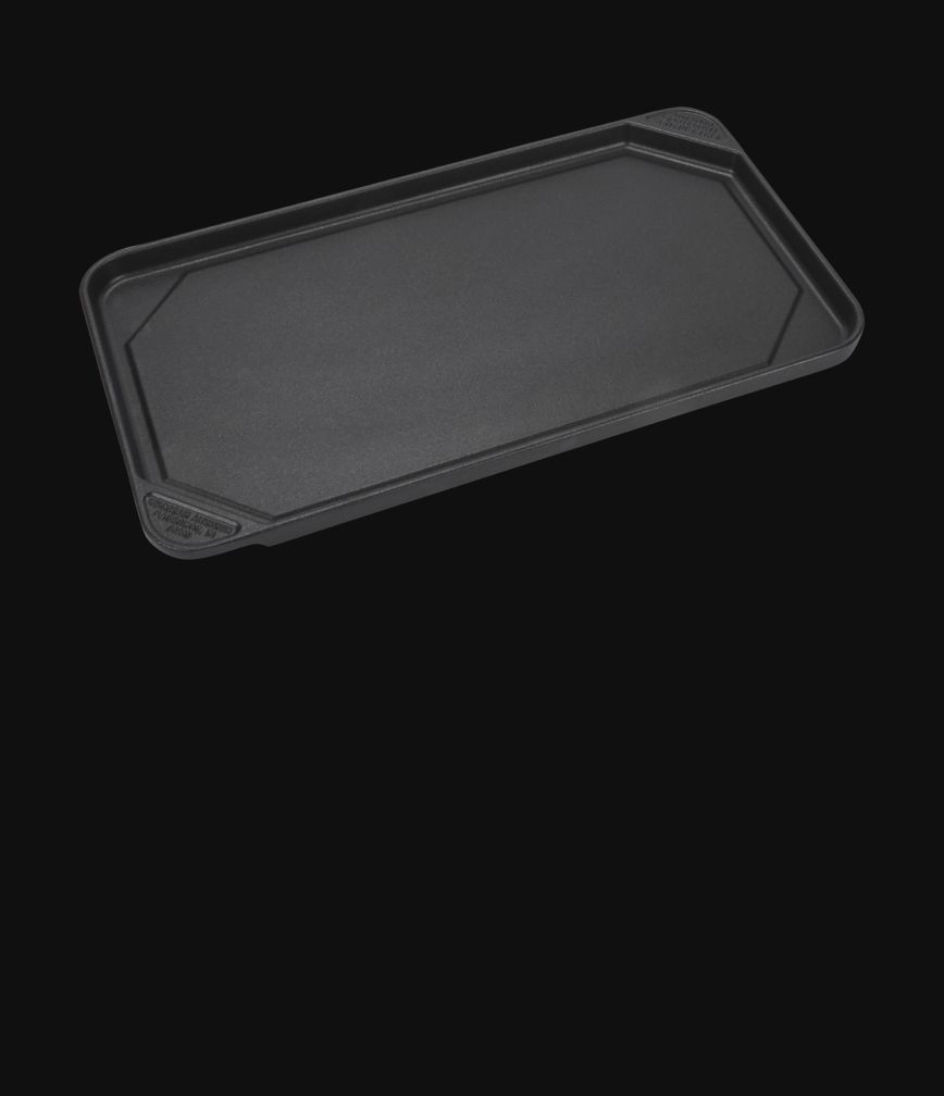 A griddle accessory isolated on a black background.
