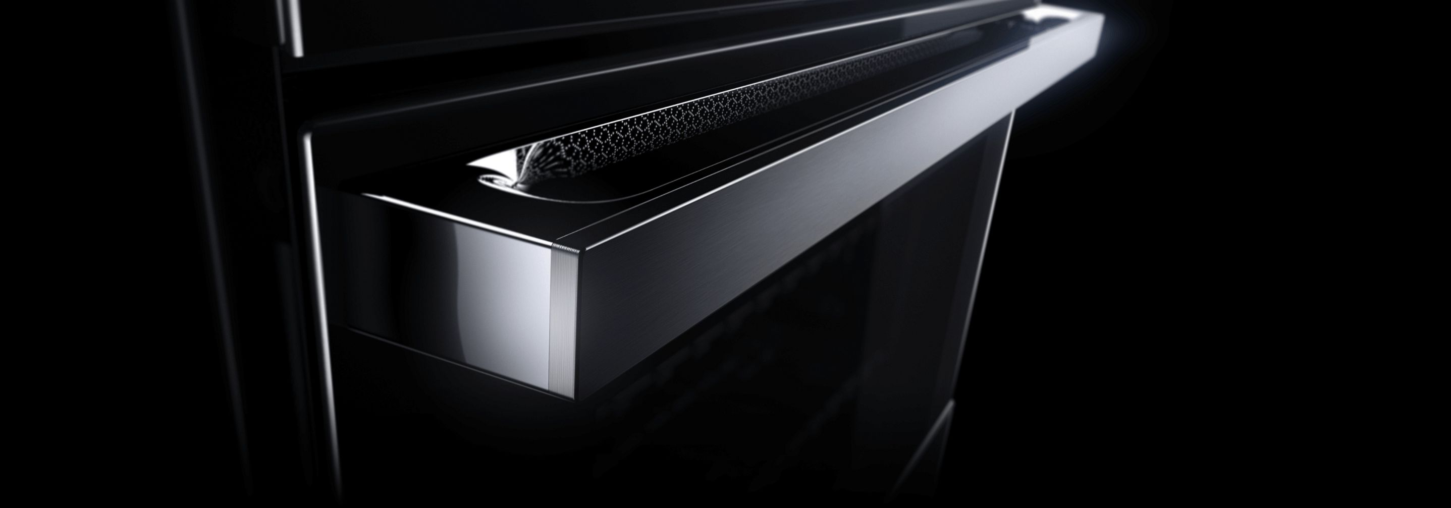 The LCD screen and handle of a JennAir® NOIR™ Design Wall Oven.