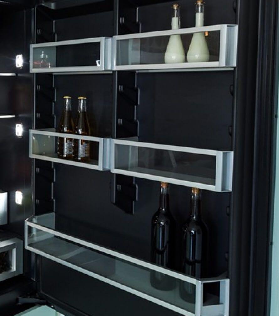 The door bins of a JennAir® Built-In Refrigerator in the Bottom-Freezer configuration.