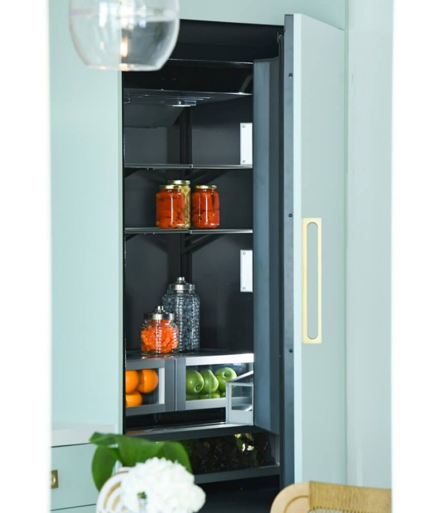 A JennAir® Built-In Refrigerator in a custom mint green panel.
