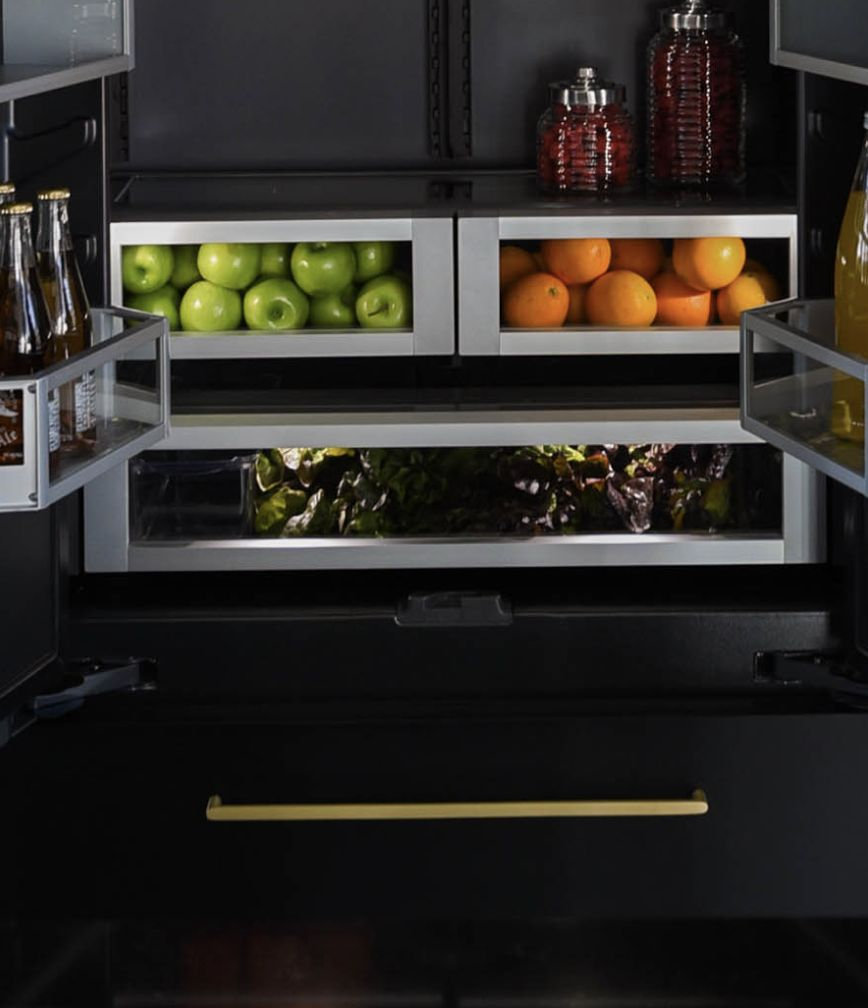 The interior of a JennAir® Built-In Refrigerator with the drawers filled with vibrant produce.