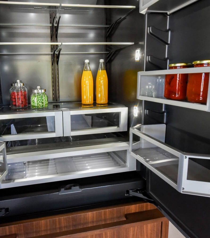 The interior of a JennAir® Built-In Refrigerator with LED theater lighting illuminating each corner of the shelving.