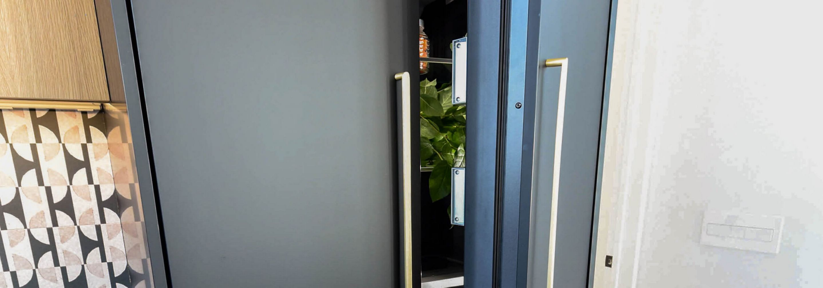 Doors of a French Door Built-In Refrigerator equipped with custom panels.
