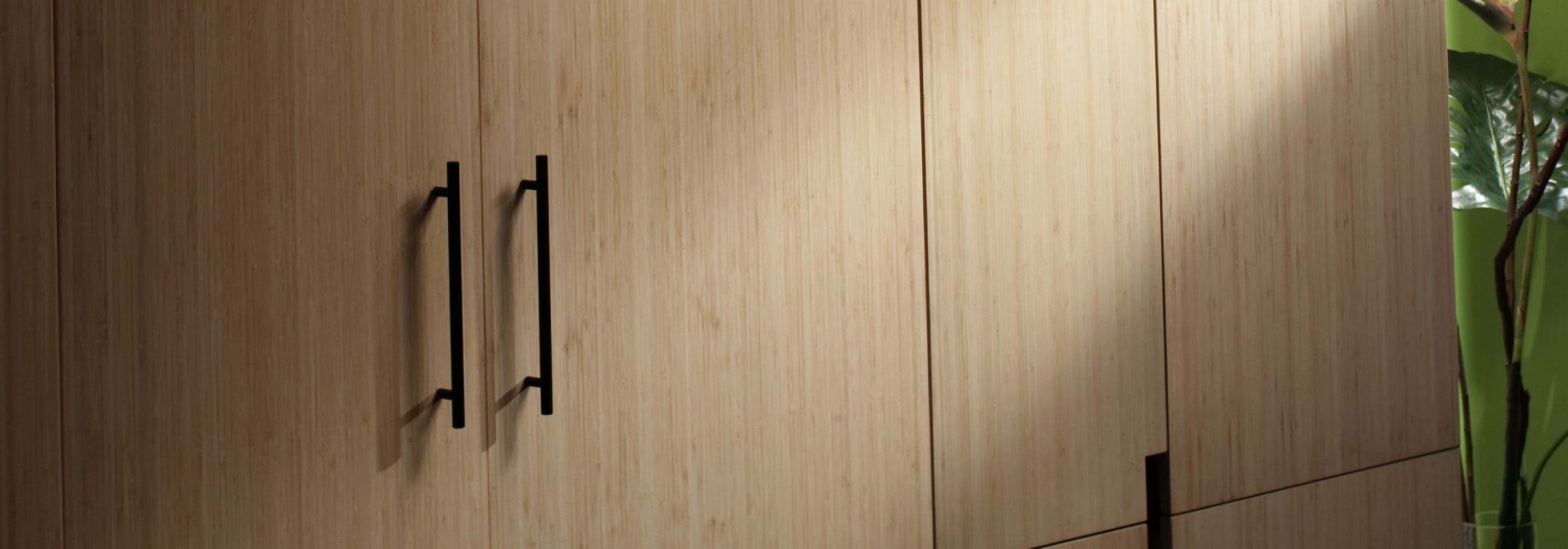 JennAir® Built-In Refrigerators in a side-by-side configuration. The panels are custom wood.