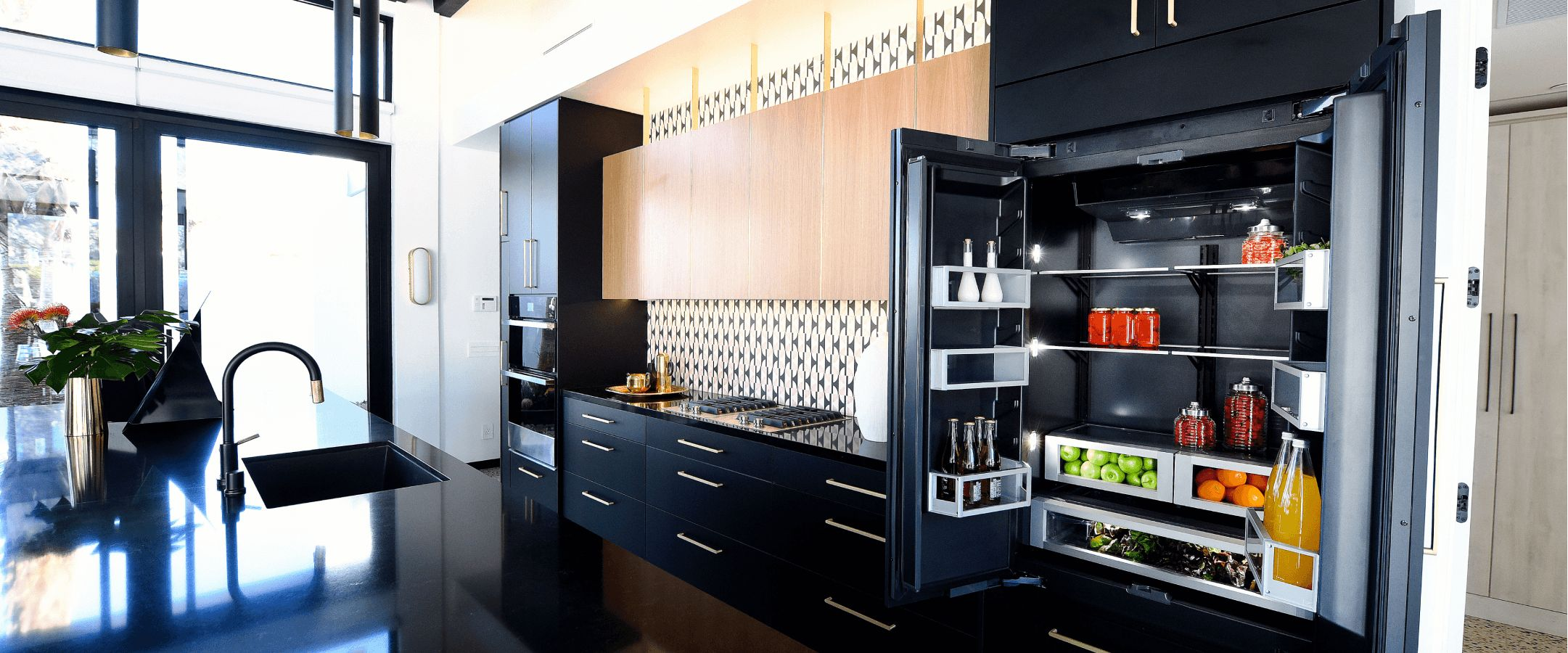 A JennAir® Built-In French Door Refrigerator in a beautifully designed kitchen.