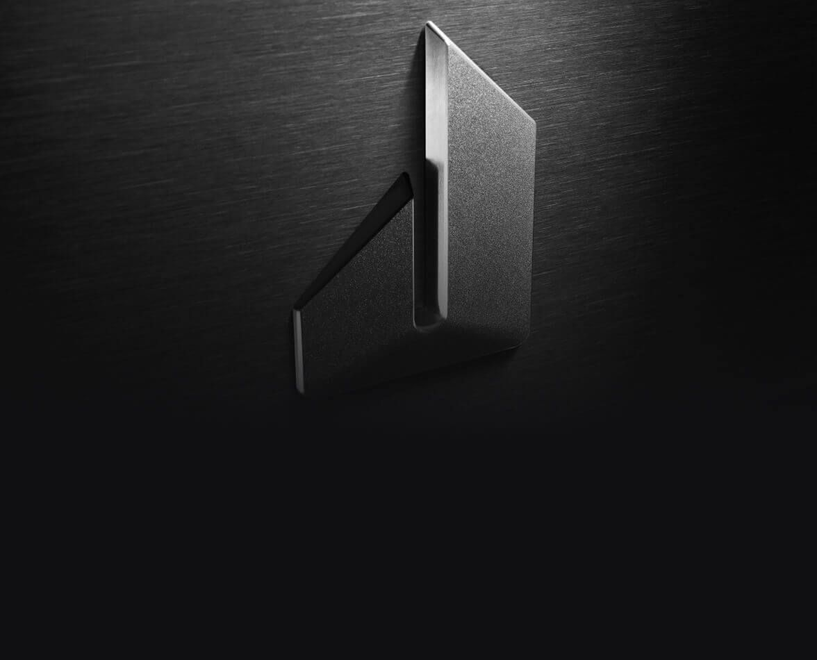 The JennAir defiant J badge isolated on stainless steel.