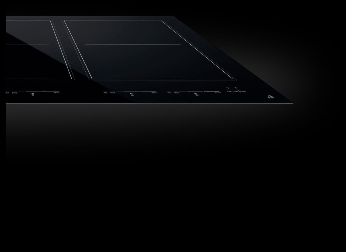 A frameless JennAir® Induction cooktop with an Oblivion Glass surface.