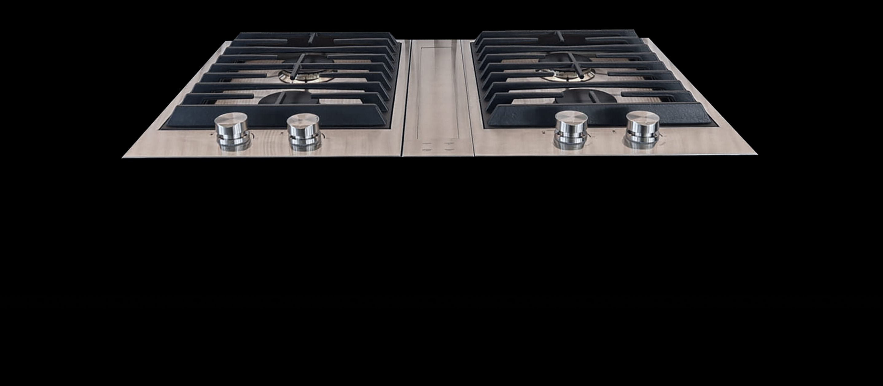 JennAir® 2-burner customized cooktops paired with a downdraft ventilation strip.