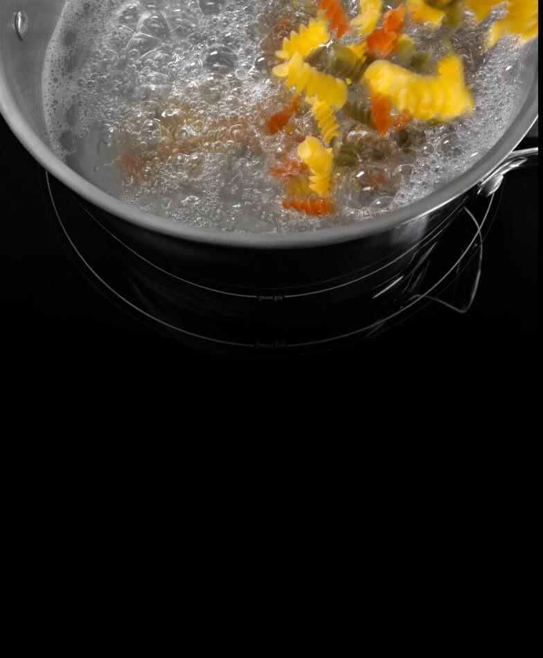 A pan boiling pasta.