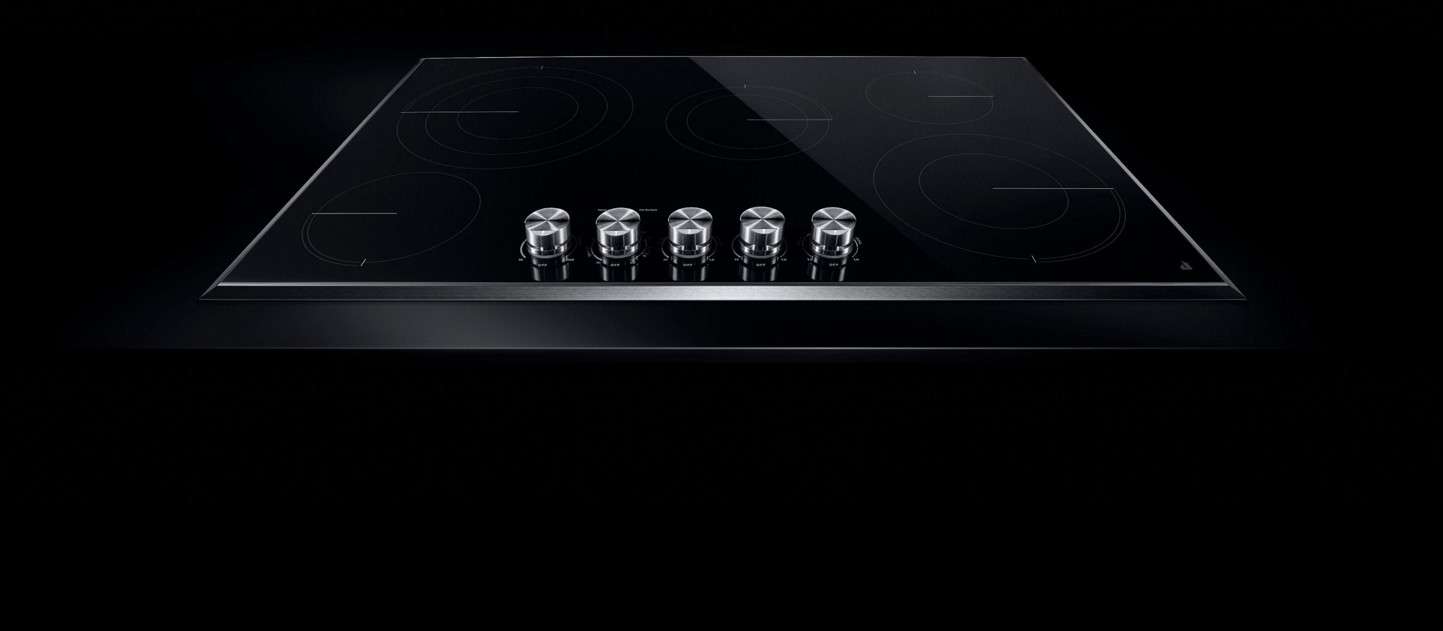 A JennAir® electric radiant cooktop with front knob controls.