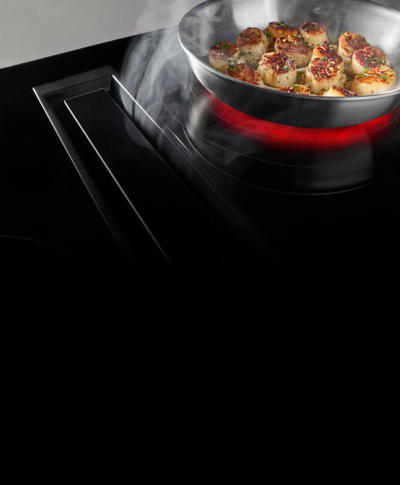 A JennAir® electric radiant cooktop with perimetric downdraft ventilation.