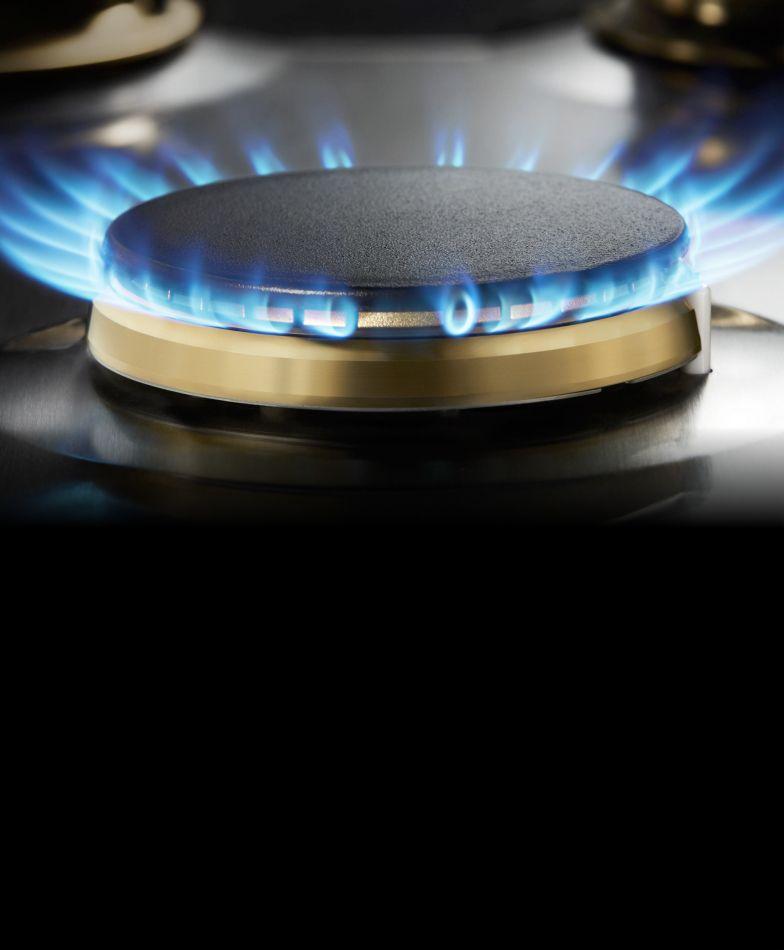 A lit dual-stacked JennAir® burner.