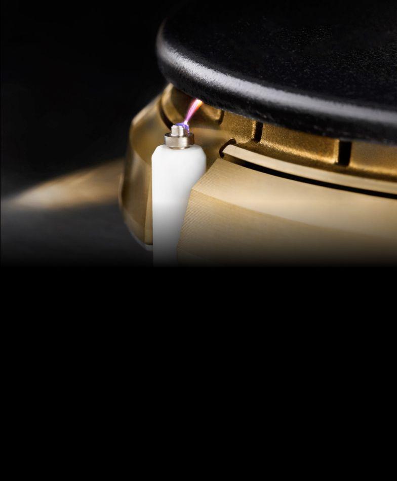 A close up of an igniting JennAir® burner.