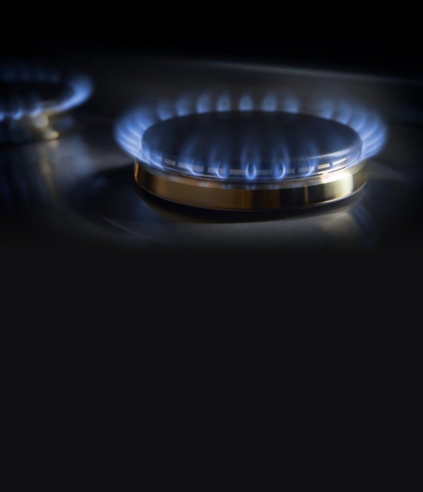 The lit burners on the 2-burner gas custom cooktop.