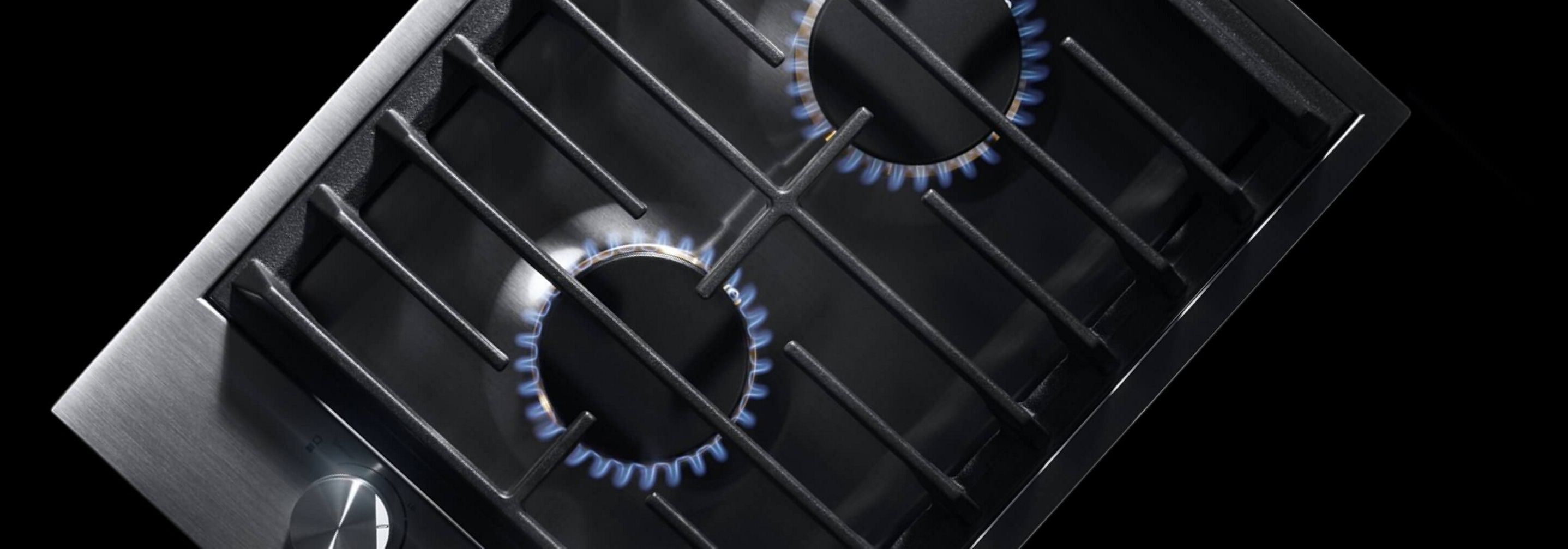 The 2-burner gas cooktop, with its burners lit.