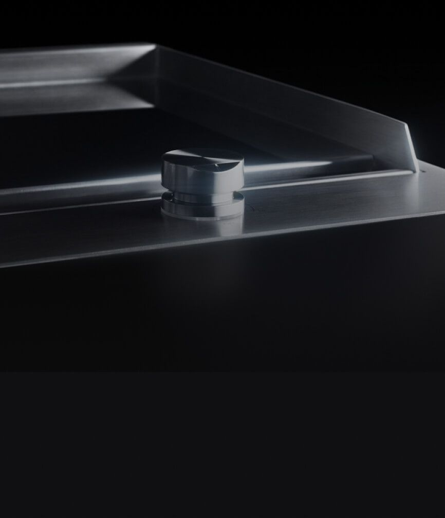 The slick chrome-infused surface of the griddle.