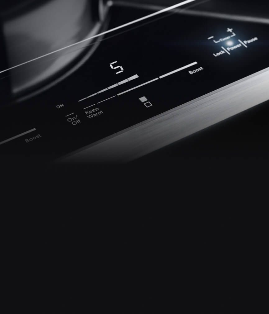 The lit controls of the 15-inch induction cooktop.