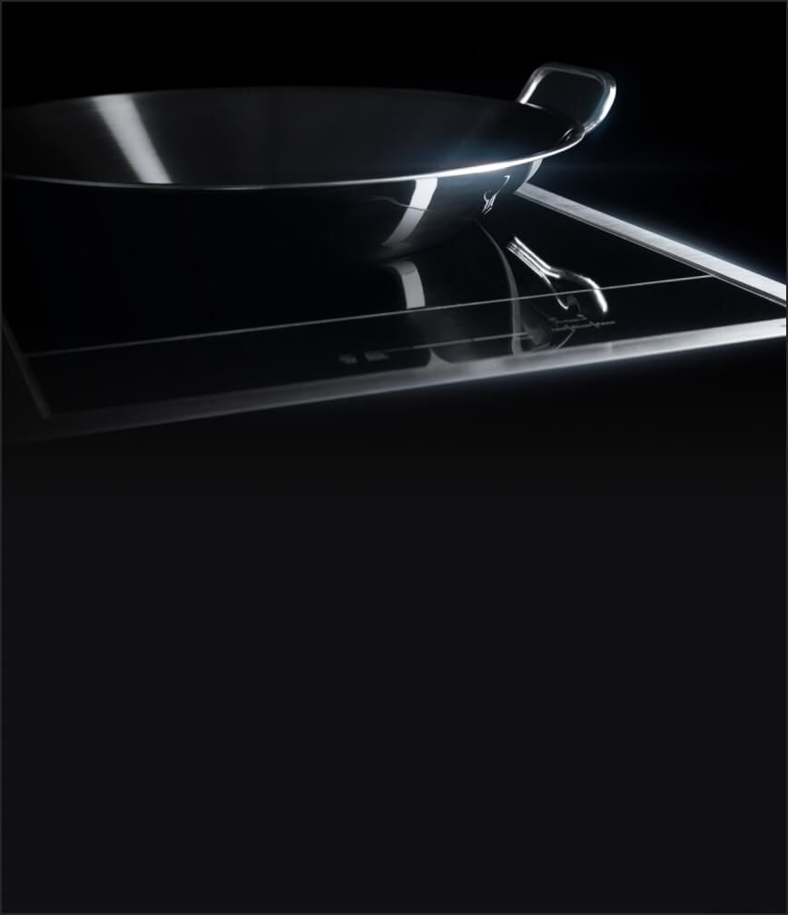 The 15-inch Induction Wok Cooktop with a stainless steel round wok fitting neatly in the concave element.