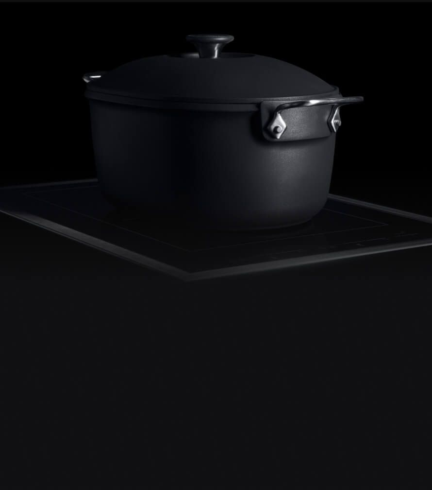 A JennAir 15-inch Induction Flex Cooktop with a cast-iron dutch oven.