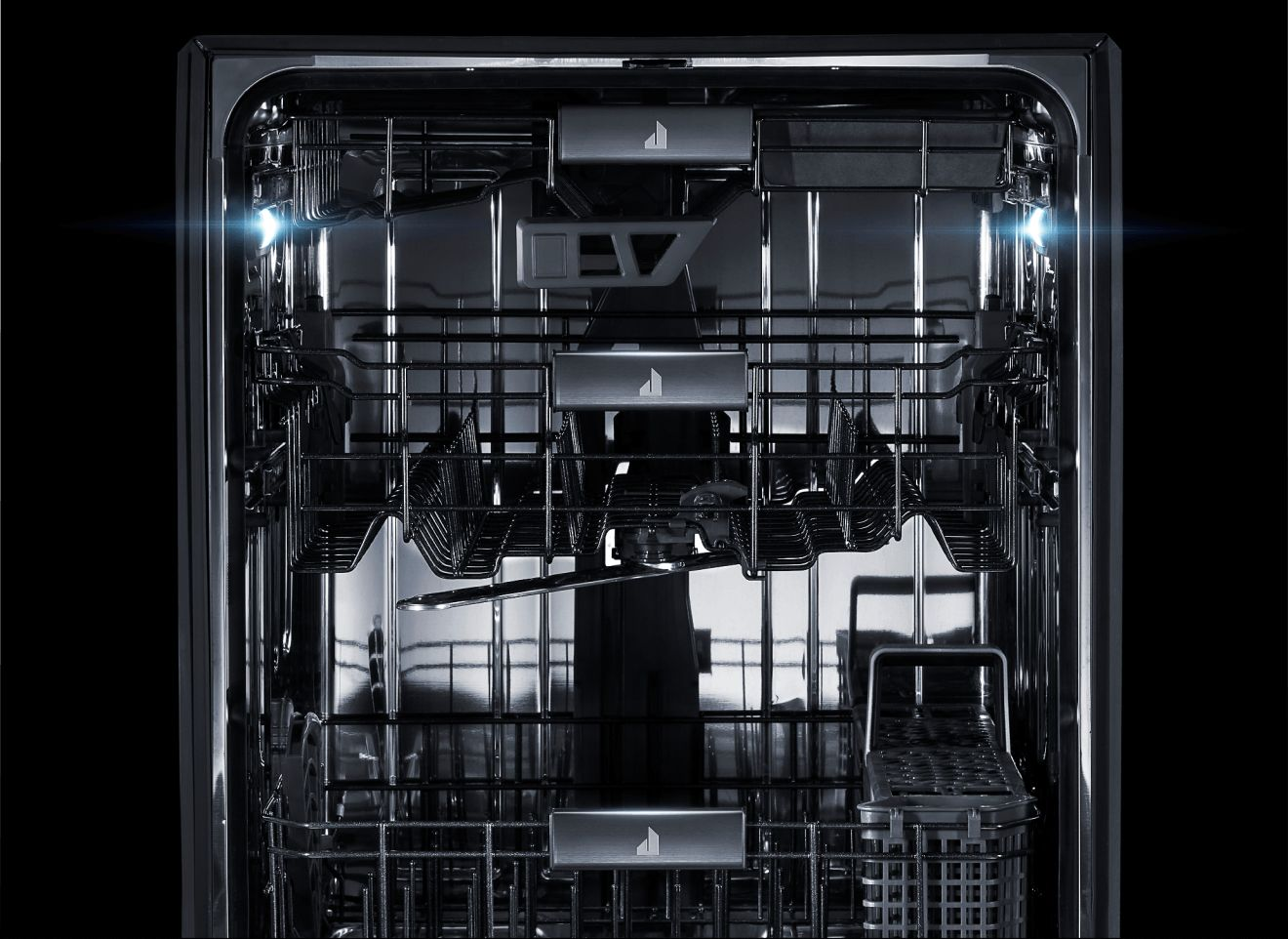 The interior of a JennAir® dishwasher, lit up and clearly visible.