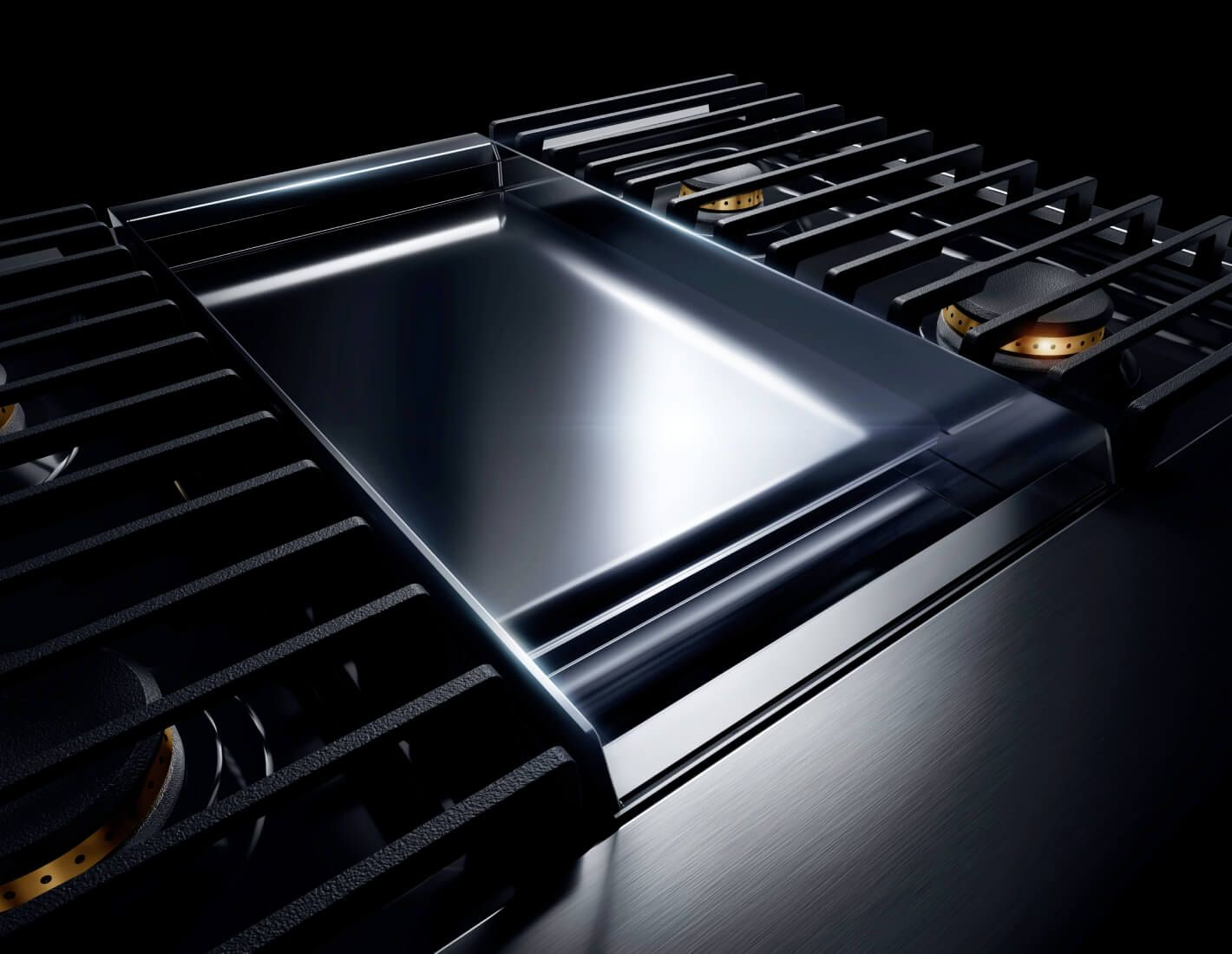 The chrome-infused griddle on a NOIR™ Design gas rangetop.