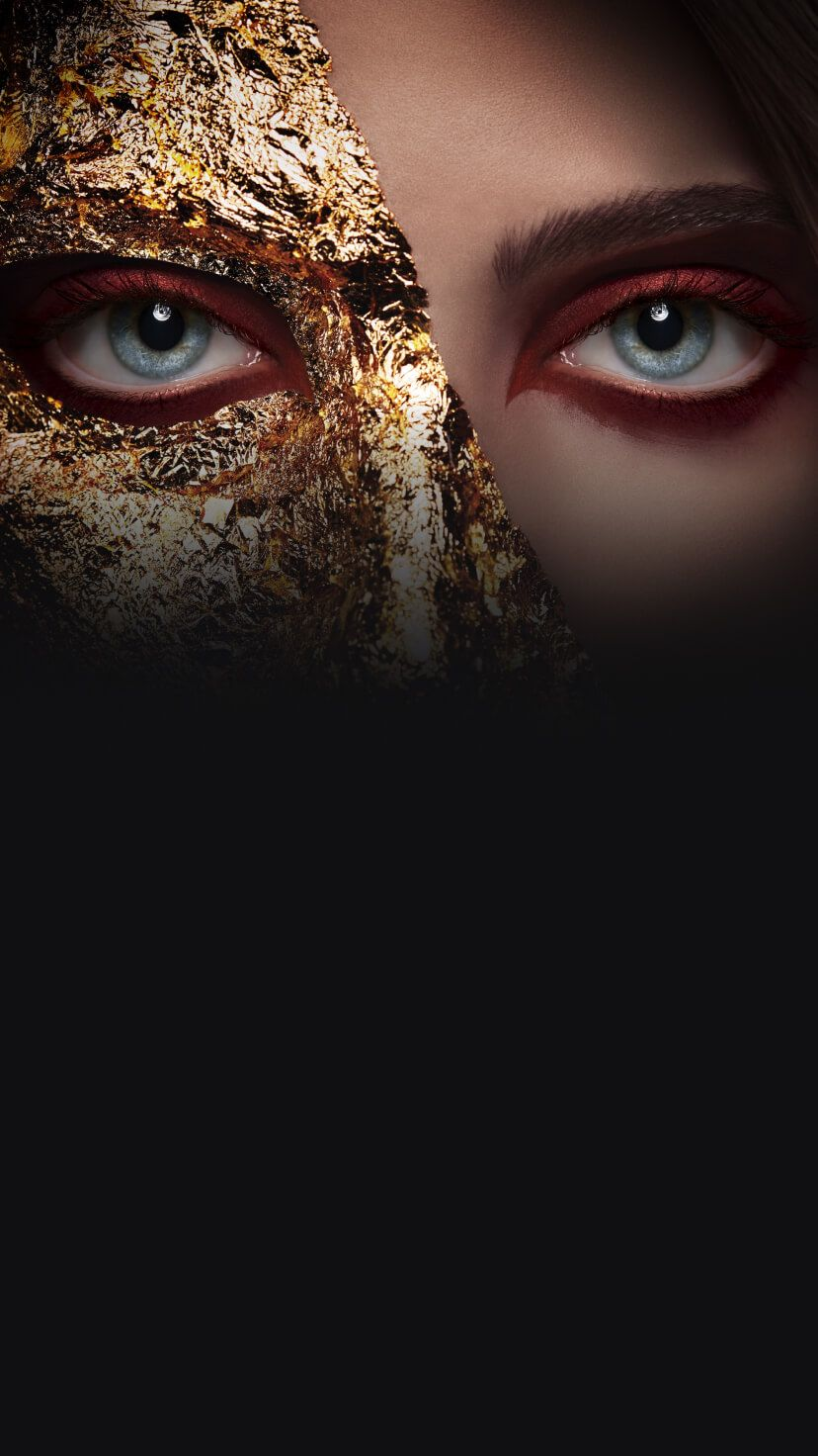 A woman with half her face in gold foil.