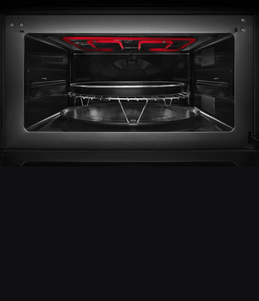 The interior of the built-in microwave or speed oven with the grill element activated.