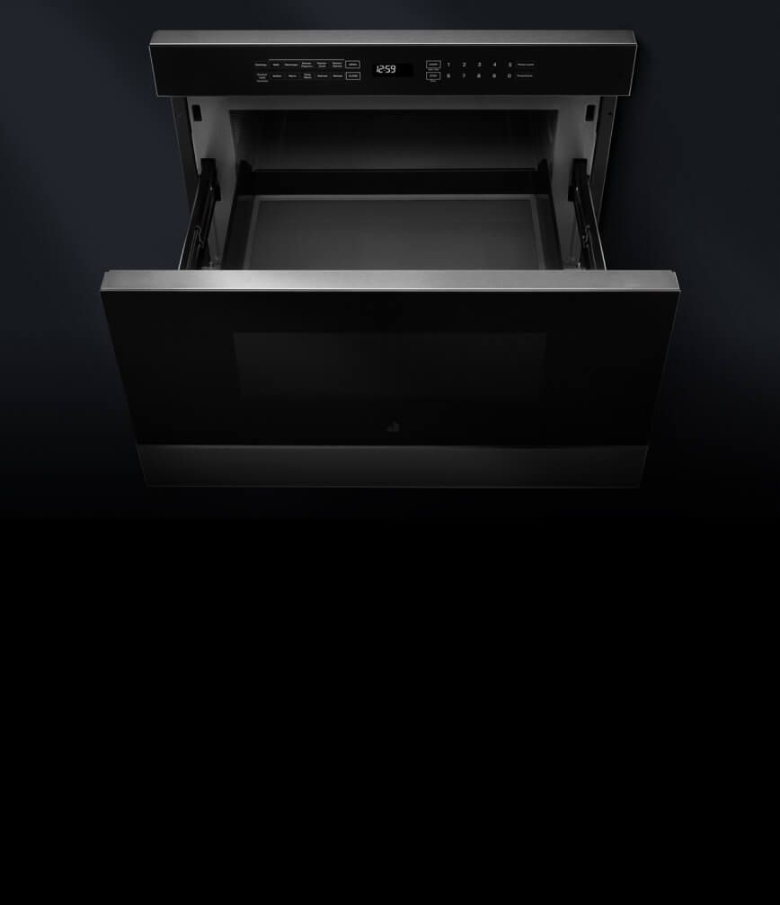 An open microwave drawer.