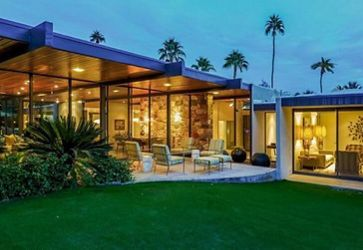 The exterior of the Dinah Shore Estate in the evening.