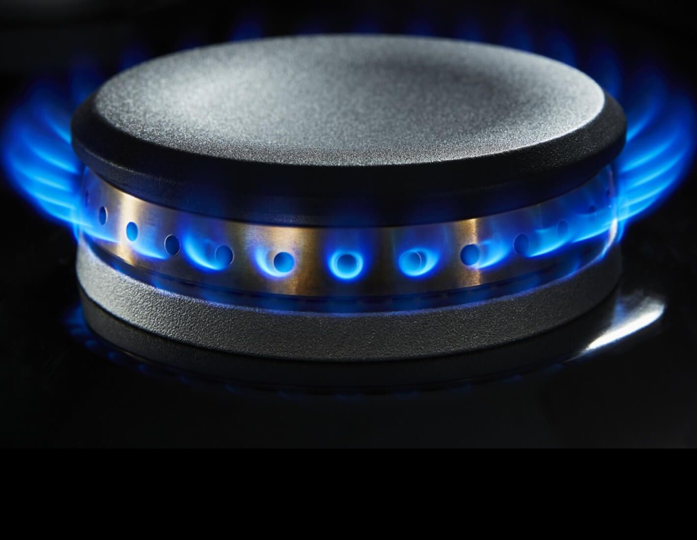 A lit dual-stacked burner.