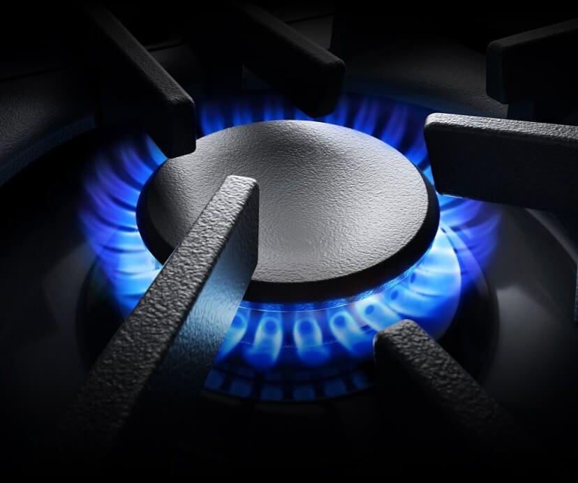A lit JennAir® RISE™ range burner.