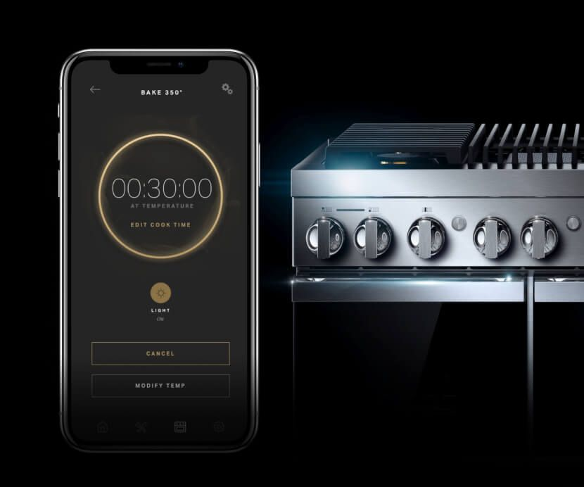 A phone showing the JennAir® app and a cook timer next to a JennAir® NOIR™ design expression range.