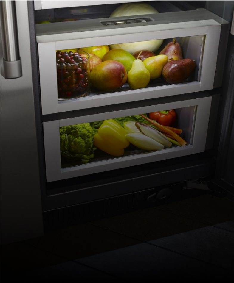 Climate-controlled produce drawers inside a JennAir[®] built-in refrigerator.