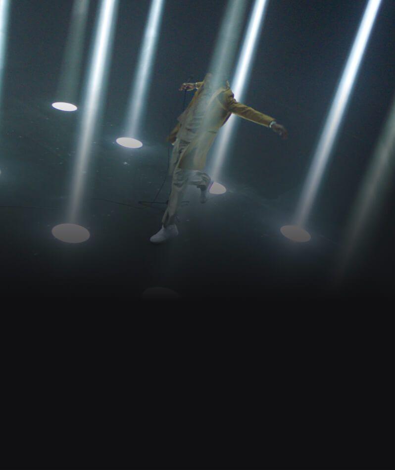 A man standing amongst beams of light.