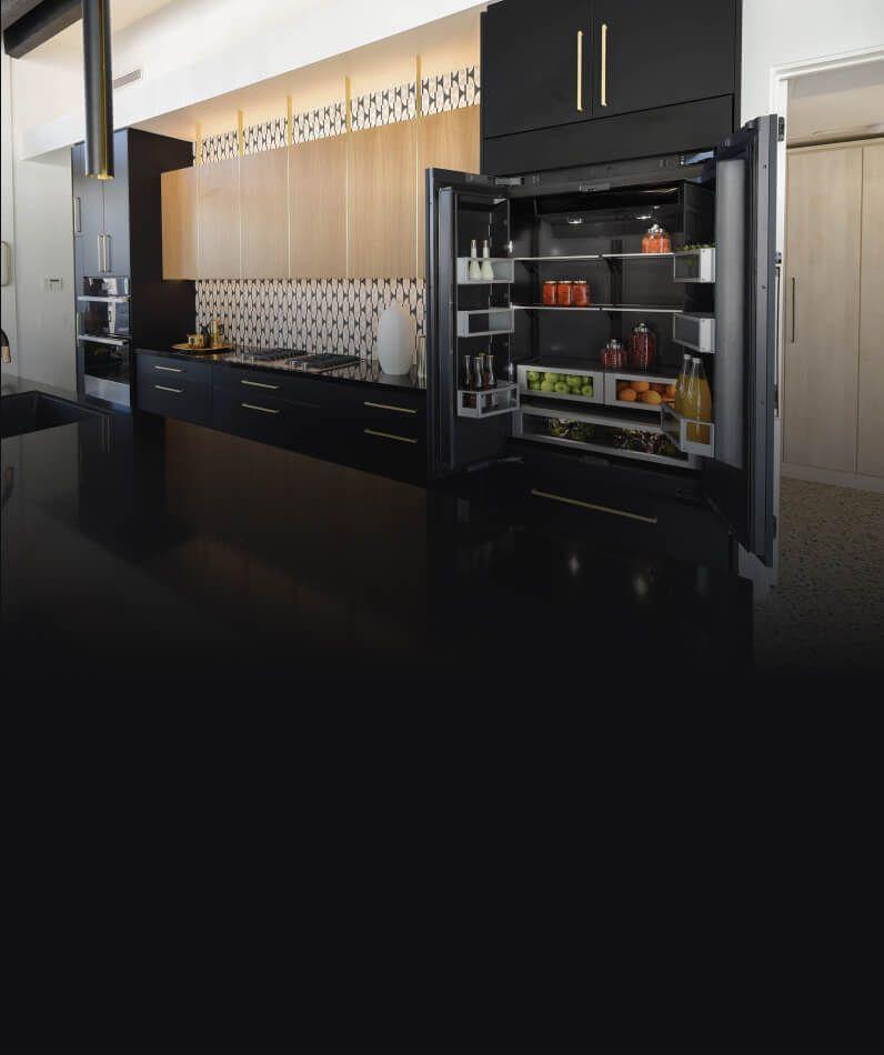 An open JennAir Built-In Refrigerator in.a kitchen.
