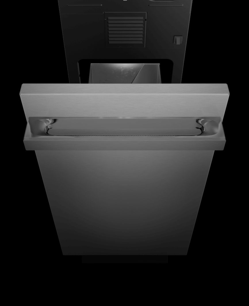 An open JennAir® Trash compactor showing the capacity.