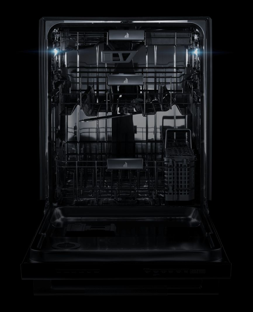 The interior of a JennAir® dishwasher, lit up by its LED lights.