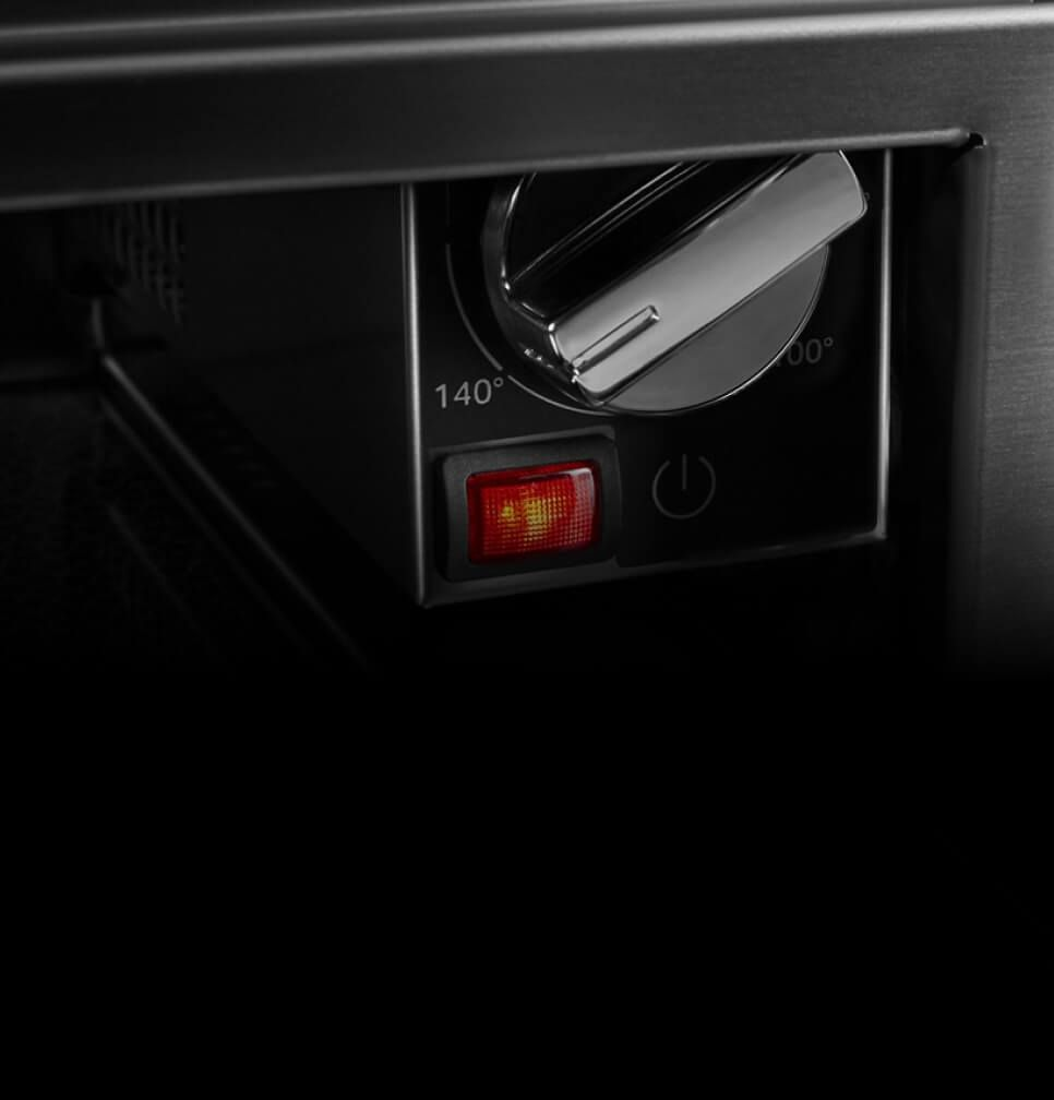 The controls inside of the warming drawer.