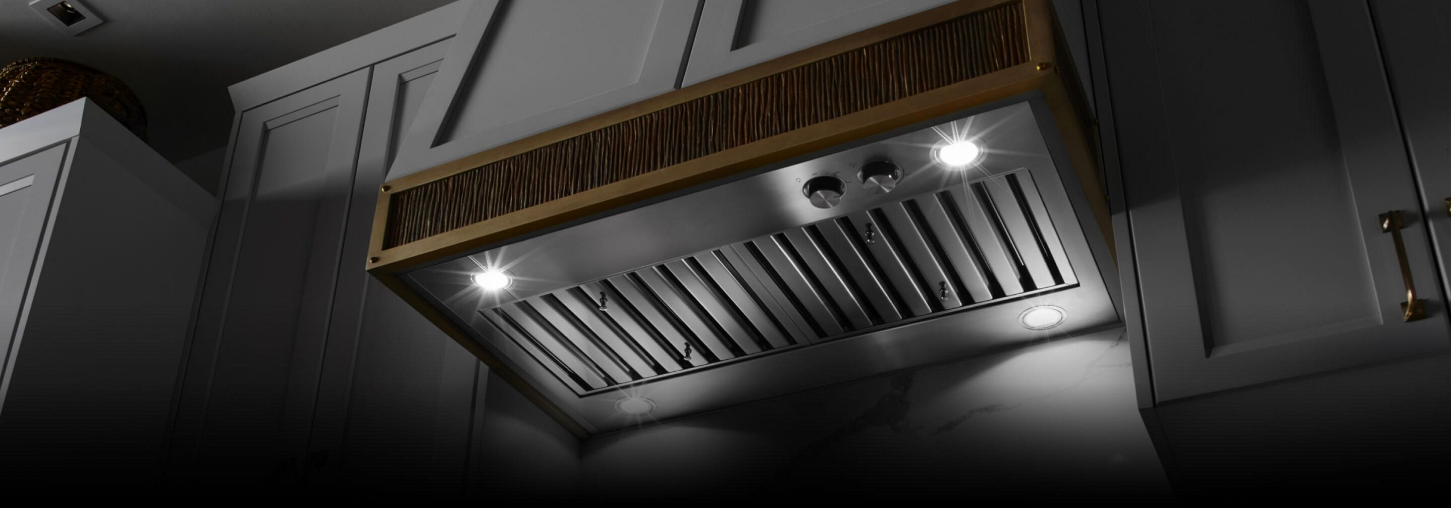 A custom hood liner inside a wooden vent hood facade.