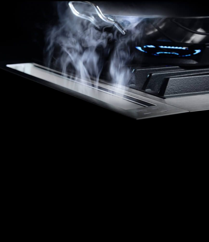 The 4-inch downdraft strip drawing steam away from the cooking surface.