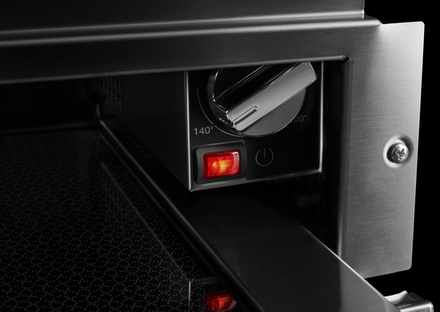 The temperature control knob in a JennAir® warming drawer.