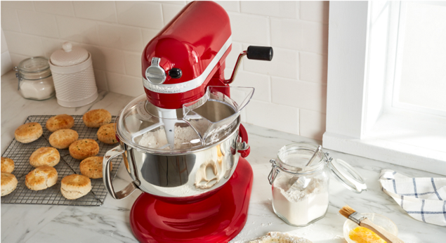 A KitchenAid® stand mixer shown with the pouring shield attached.